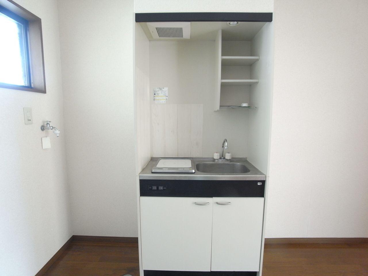左右に洗濯機置場と冷蔵庫スペース